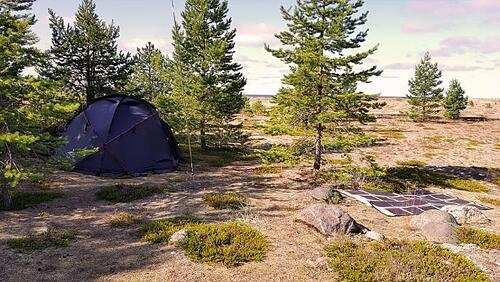 Tent in remote area with PowerFilm Foldable Solar Panel