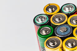 Different colored batteries lined up in a row
