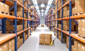 Warehouse aisle lined with boxes and pallet jacks