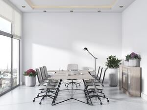 Well lit conference room with a large glass window